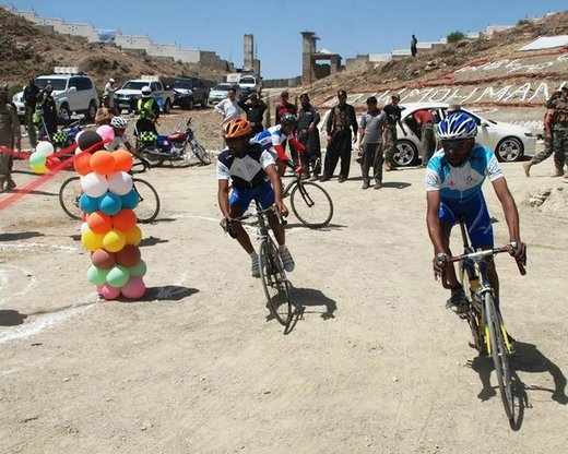Cyclists race towards the finish line June 4 in Mohmand Agency during the Tour de Mohmand contest. [Danish Yousafzai]
