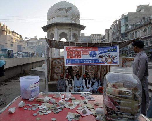 A Pakistani organisation last August in Chowk Yadgar collects donations to help survivors of an earthquake. Pakistan recently banned 60 extremist organisations from collecting funds during Ramadan. [Adeel Saeed]