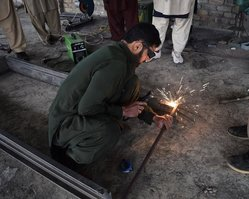 A TUSDEC trainee practices welding in Malakand Division in May. [Syed Ansar Abbas]