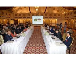 Pakistani and Tajik officials confer in Islamabad during the June 15-16 5th session of the Pakistan-Tajikistan Joint Commission on Trade, Economic and Scientific-Technical Co-operation. [Javed Mahmood]