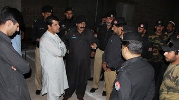Peshawar Capital City Police Officer Mubarak Zeb (centre) June 22 in Mawtani talks to other police officers at a check-point in Matani. [Javed Khan]