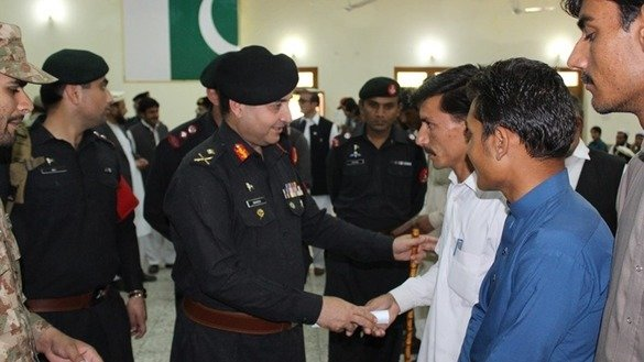 FC Inspector Gen. and Maj. Gen. Shaheen Mazhar Mahmood April 22 in Bajaur Agency gives appointment letters to army recruits. [Hanif Ullah]