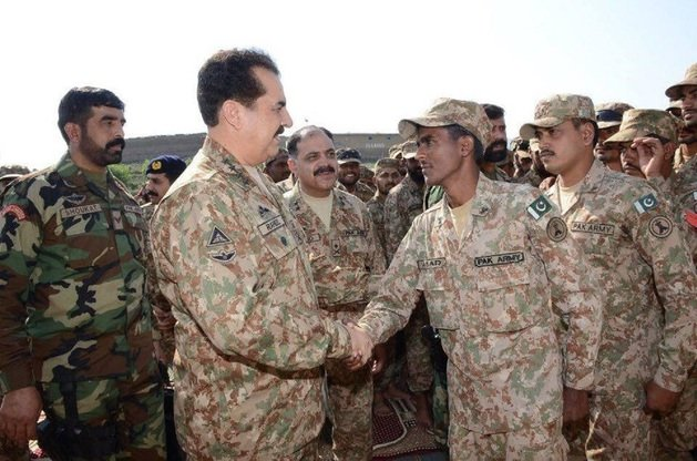 Pakistani army Chief of Staff Gen. Raheel Sharif (left) greets soldiers in North Waziristan July 6. Raheel spent Eid with troops on the battlefield. [Courtesy of ISPR]