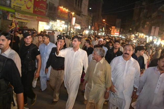 Peshawar Senior Superintendent of Police Abbas Majeed Marwat (in white, centre) visits central Peshawar July 4 to inspect security before Eid ul Fitr. [Javed Khan]