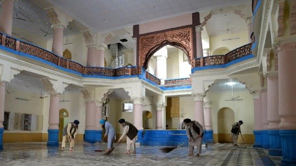 Sikhs sweep the floor at the historic Bhi Beba Singh temple in Peshawar March 29. The temple, which shut down in 1947, re-opened that day for worship. [Shahbaz Butt]