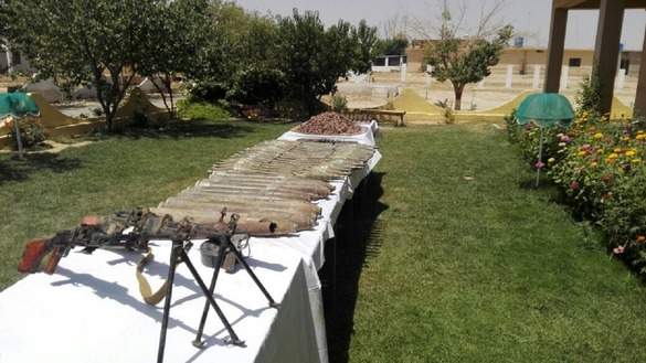 Pakistani authorities display seized weapons and explosives in Quetta July 12. The Frontier Corps confiscated the items in the Toba Achakzai area of Balochistan that day. [Abdul Ghani Kakar]