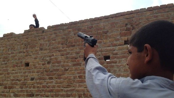 Children in Peshawar play with toy guns July 3. [Danish Yousafzai]