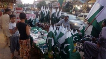 Pakistanis August 14 in Islamabad buy flags as part of peaceful Independence Day celebrations. [Imdad Hussain]