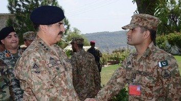 Pakistani Army Chief Gen. Raheel Sharif (beret) August 23 in Kurram Agency shakes hands with a soldier participating in counter-terrorism operations in the agency. Troops nationwide are pursuing militants. [Courtesy of ISPR]