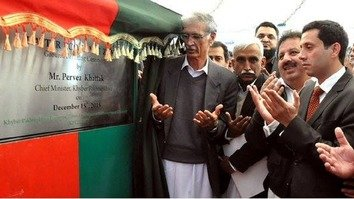 KP Chief Minister Pervez Khattak (left) offers prayers at the ground-breaking of Hattar Economic Zone in Haripur District on December 15, 2015. KP authorities have launched a massive industrialisation initiative to fight militancy by creating jobs. [Courtesy of Adeel Saeed]
