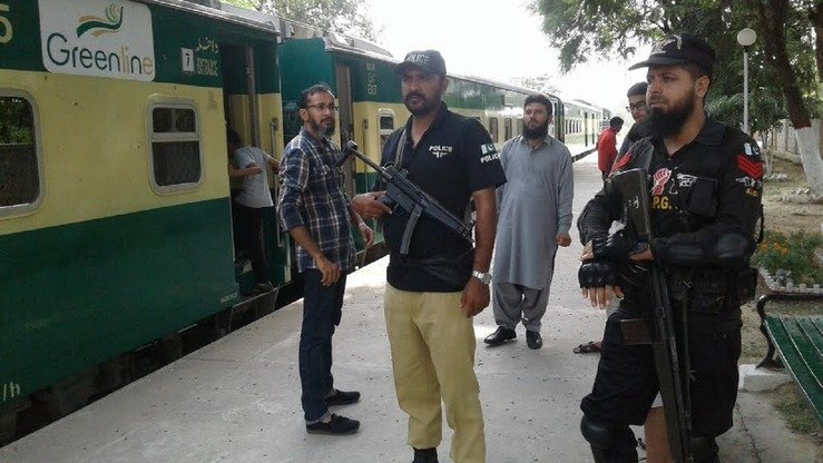 An Pakistan Railways Police officer and a Pakistani army commando September 11 guard an Islamabad railway station. [Javed Mahmood]