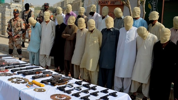 Punjab authorities September 20 in Lahore display seized arms and suspected militants in custody. [Amna Nasir Jamal]