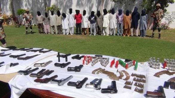 Sindh Rangers display a large cache of arms and ammunition recovered from suspected militants in September. [Amna Nasir Jamal]