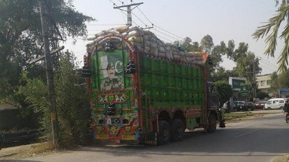 A truck loaded with consumer goods departs for Afghanistan from Islamabad on October 18, 2016. Commercial vehicles supplying goods from Pakistan to Afghanistan businessmen and NATO forces are now safe after the launch of military and intelligence based operations against militants in Pakistan, statistics show. [Javed Mahmood]