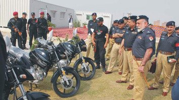 Khyber Pakhtunkhwa Inspector General of Police Nasir Durrani inspects motorbikes given to KP Elite Force after inaugurating the Special Combat Unit office in Nowshera September 29. [Courtesy KP Police]