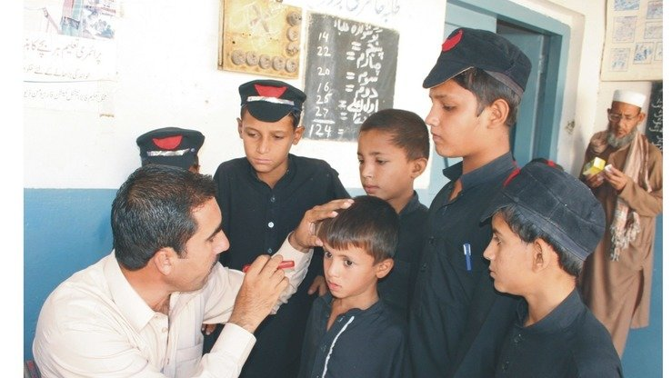 A doctor examines schoolchildren at the Eye Out-Patient Department of the Mohmand Agency Headquarters Hospital October 20. [Courtesy Directorate of Health FATA]