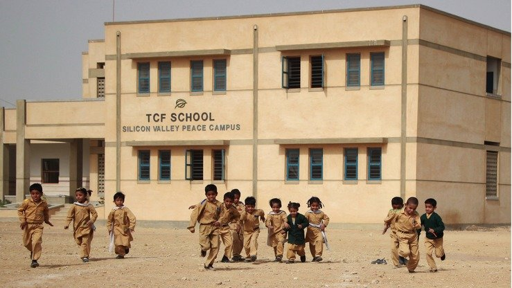 Children play outside a school built in 2015 by TCF in Karachi. TCF is building 141 Schools for Peace across Pakistan in memory of the children and teachers slain in the Army Public School terrorist massacre in Peshawar. [Courtesy of Adeel Saeed]