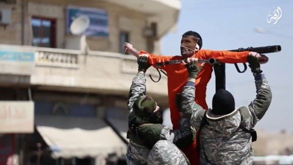 "A screenshot of a recent ISIL video called ""Revered Glory"" shows group members tying up a man in a public square in al-Raqa, Syria, before being executed. ISIL propaganda like this has witnessed a noticeable shift away from claims of building an Islamic 'caliphate' and instead has focused mainly on violence."
