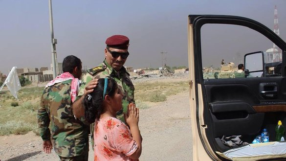 An Iraqi girl thanks the security forces for rescuing her family from the 'Islamic State of Iraq and the Levant' south of Mosul. [Photo courtesy of the Iraqi Ministry of Defence]