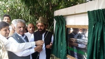 KP Governor Zafar Iqbal Jhagra (centre) inaugurates a potable water scheme in Khyber Agency on June 9. Pakistan is focusing on reconstruction and rehabilitation of the terrorism-hit tribal belt. [Courtesy of KP Governor House].
