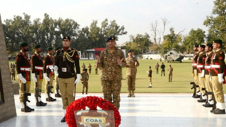 New army chief Gen. Qamar Javed Bajwa (hands upturned in prayer) presents a floral wreath at a martyrs' monument in Peshawar on November 30. [ISPR]