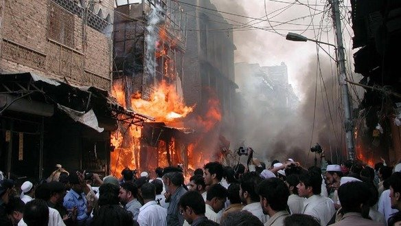 Pakistanis gather at the Meena Bazaar in Peshawar on October 28, 2009, after a car bombing killed more than 90 persons, mostly women and children. Terrorism cost Pakistan about 60,000 lives and US $118 billion in losses from 2002 to 2016. [Courtesy of Adeel Saeed]