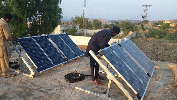 Technicians install solar panels in Wana, South Waziristan, April 28. [Courtesy of Ashfaq Yusufzai]