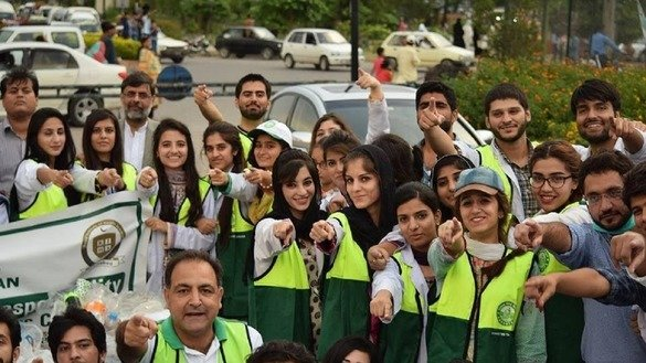 Members of the Islamabad Galaxy Leo Club are shown in August as they promote tree planting in the city. The club creates awareness of education and literacy in Pakistan. [Javed Mahmood]