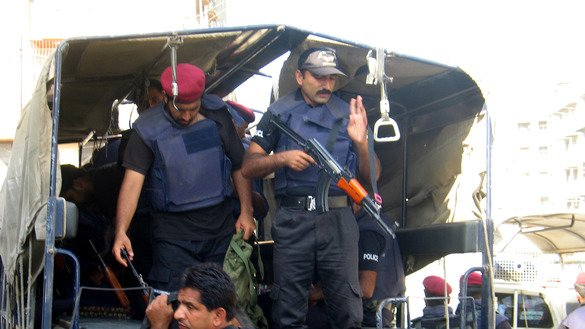 Karachi Police on December 8 arrive at a police station to participate in a crackdown on Taliban militants. [Zia Ur Rehman]