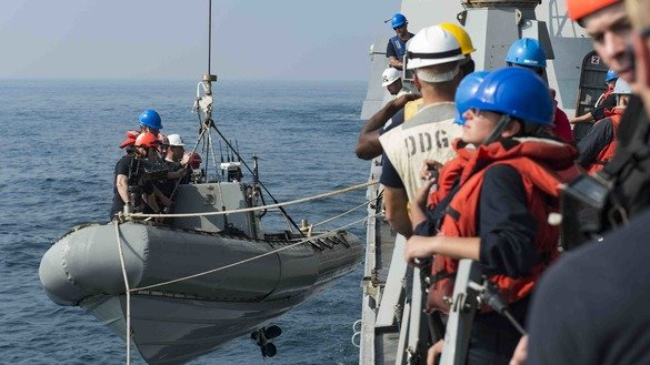 Sailors assigned to the guided-missile destroyer USS Nitze (DDG 94) render assistance to a distressed Iranian vessel in November. [Photo courtesy of the US Navy]