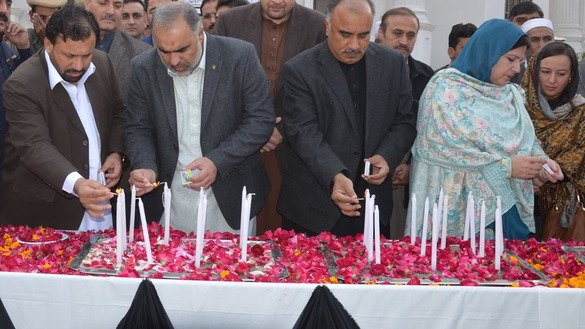 KP Assembly Speaker Asad Qaiser (second from left) and provincial cabinet members on December 16 in Peshawar light candles to commemorate the second anniversary of the APS massacre. [Javed Khan]