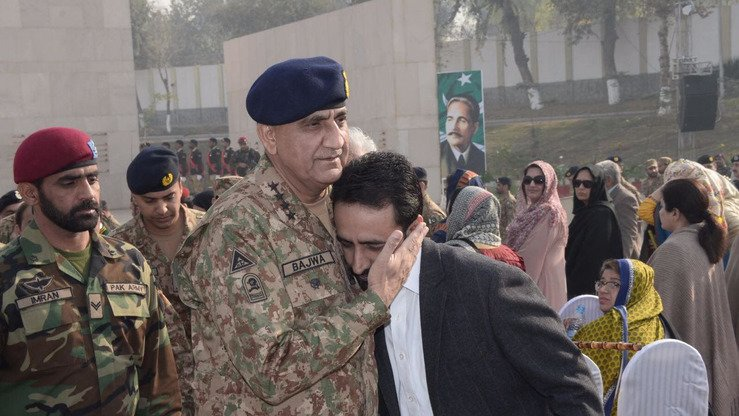 Pakistani army chief Gen. Qamar Javed Bajwa on December 16 in Peshawar embraces a survivor of the 2014 APS massacre. [Courtesy of ISPR]