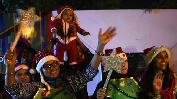 Pakistani Christian girls on December 21 in Karachi dance to celebrate the coming Christmas. [ASIF HASSAN/AFP]