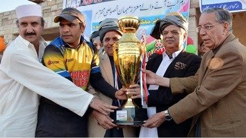 KP Governor Iqbal Zafar Jhagra (handkerchief in breast pocket) on December 21 in Khyber Agency awards a trophy to the winning team at the Khyber Peace Games-2016. [Courtesy of KP Governor House]