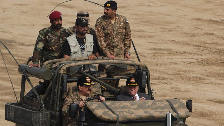 Pakistani Prime Minister Mian Muhammad Nawaz Sharif (right) sits next to then-army chief Gen. Raheel Sharif during a military exercise in Bahawalpur District November 16. India is partnering with foreign militaries to fight terrorism. [SS Mirza/AFP]