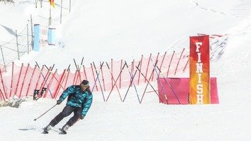 A skier crosses the finish line February 2 during the 2017 Malam Jabba International Alpine Ski Cup in Swat District, Khyber Pakhtunkhwa. [Ashfaq Yusufzai]