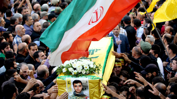 Members and supporters of Lebanon's Hizbullah carry the coffin of Jalal al-Effeh, killed in combat in Syria alongside regime forces, during an October 2016 funeral procession in a southern suburb of Beirut. Iran has extended its influence in Syria by arming and equipping groups such as Hizbullah in violation of international agreements. [Anwar Amro/AFP]