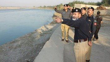 Senior police officials on November 25 inspect security measures in areas close to Mohmand Agency, FATA. [Javed Khan]