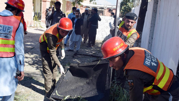 Rescue workers respond to a terrorist attack at the courthouse in Tangi Tehsil, Charsadda District, Khyber Pakhtunkhwa, February 21. Three suicide bombers tried to inflict mass casualties that day, but police foiled their plans. [Javed Khan]