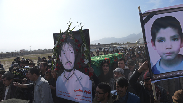 "Afghan mourners on November 23, 2016, carry the coffins of some of the 27 victims killed in a bloody mosque bombing in Kabul claimed by the ""Islamic State of Iraq and the Levant"" (ISIL). [Shah Marai/AFP]"