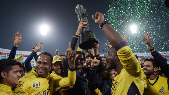 Cricketers of Peshawar Zalmi celebrate their victory over the Quetta Gladiators in the final of the Pakistan Super League (PSL) in Lahore March 5. [Aamir Qureshi/AFP]
