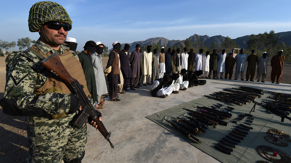 Pakistani para-military forces present suspected militants and seized weapons to media in Khyber Agency March 3. Troops rounded up the suspects during Operation Radd-ul-Fasaad. [Abdul Majeed/AFP]