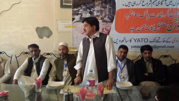 Youth Anti Terrorism Organisation (YATO) Chairman Muhammad Asif speaks in Peshawar February 22 at a workshop on the perils of radicalism and the importance of peace to development and prosperity. [Adeel Saeed]