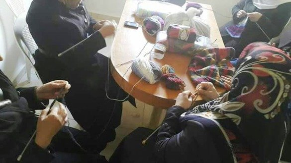 Syrian women knit warm winter clothing as part of a small enterprise project supported by Damma, a women-founded non-governmental organisation. [Photo courtesy of Damma]