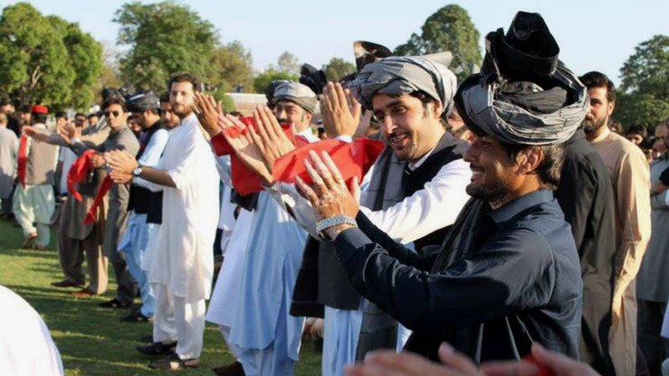 Men of all ages perform a collective Attan for Peace in Peshawar on April 7 to convey to the world that Pashtuns are peaceful and music-loving people who have nothing to do with terrorism and extremism. [Courtesy of Attan for Peace organisers]
