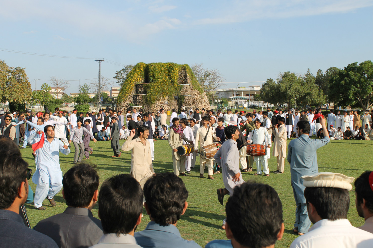 Men perform a collective Attan for Peace in Peshawar on April 7. [Courtesy of Attan for Peace organisers]