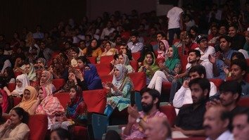 An audience of all ages watches a performance during opening night of the Tamasha Festival April 7. [Amna Nasir Jamal]