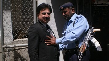 Armed police official searching a senior lawyer at the Islamabad District Courts on April 15, 2017. Islamabad police have established several gates manned by armed personnel at the district courts for the protection of judges, lawyers and general public. [Javed Mahmood]