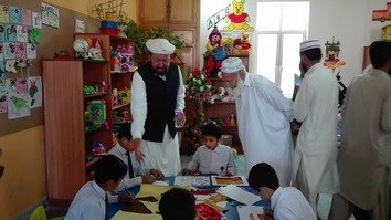 Fazl-e-Rabi, left, president of the British Pashtoon Association, visits classes at the Zamung Kor orphanage in Peshawar April 9. [Courtesy of Karwan Tanzeem]