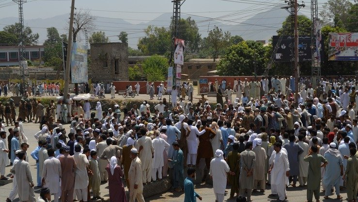 Pakistanis gather near a power station during a protest against power cuts in the Dargai area of Malakand District, Khyber Pakhtunkhwa, on May 29. The protests turned violent as crippling electricity cuts left hundreds of thousands of people without power in soaring temperatures during the first two days of the holy fasting month of Ramadan. [AFP]